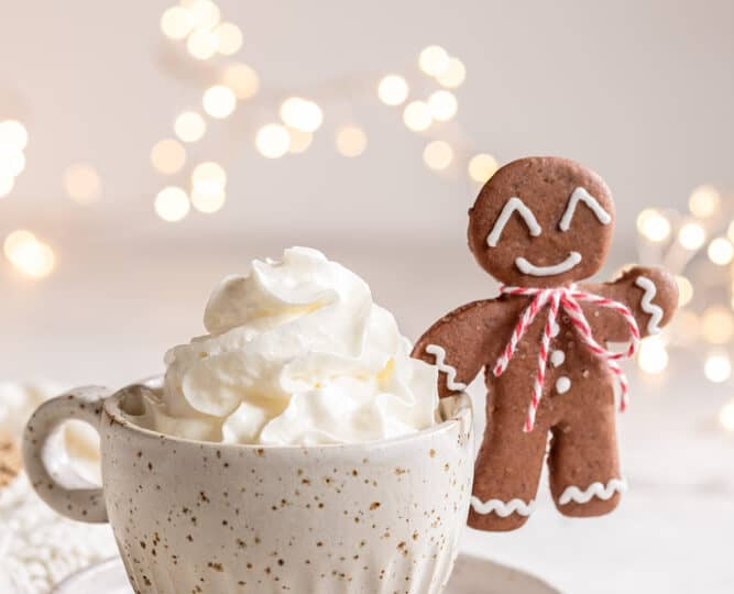 Gingerbread cookie man with a Gingerbread latte for Christmas holiday