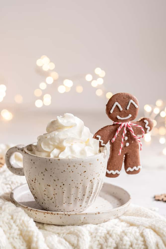 Gingerbread cookie man with a hot Gingerbread Latte for Christmas holiday